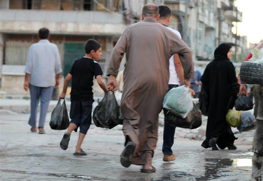 Tiêu điểm - Dân thường Syria kiếm ăn trên 'con đường tử thần' (Hình 3).