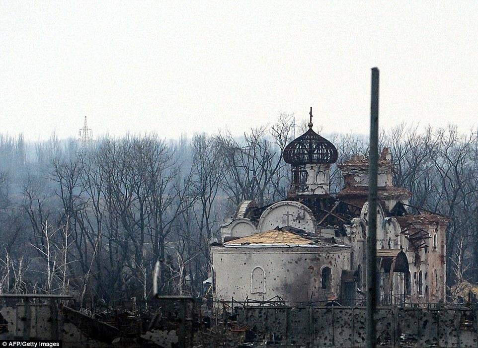 """Chùm ảnh: Nỗi đau """"ngày tận thế"""" tái hiện tại miền đông Ukraine 12"""