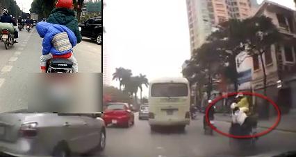 Video: Cháu bé suýt rơi khỏi xe máy vì ngủ gật 4
