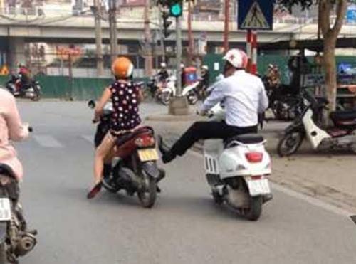 Clip thanh niên đạp xe cô gái mang bầu ở Hà Nội gây phẫn nộ 1