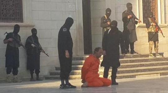 IS chặt đầu tù nhân để 'giáo dục' trẻ em thánh chiến 1