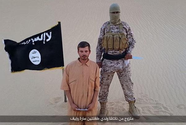 IS tung video nạn nhân quỳ mọp, nói sẽ bị hành quyết 1