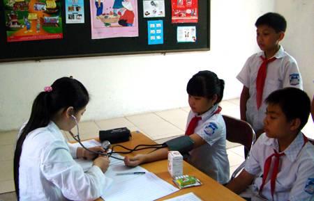 Bộ GD-ĐT ra quy định mới về thu bảo hiểm y tế 1