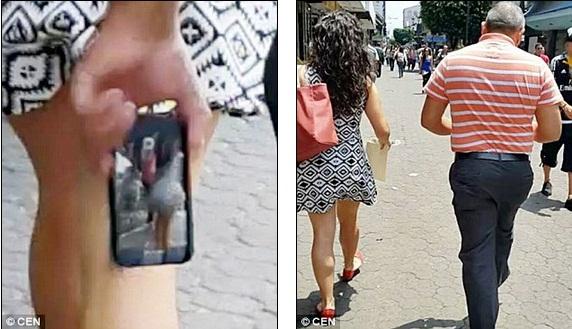 Gã đàn ông quay trộm phụ nữ mặc váy ngắn giữa phố bị bắt tại trận 1