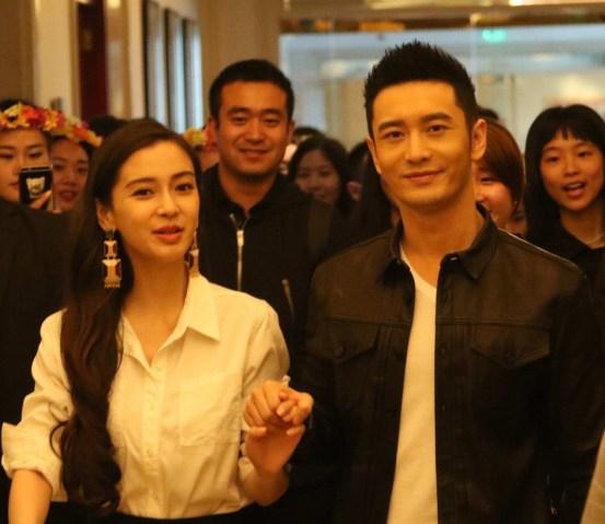 Huỳnh Hiểu Minh nắm chặt tay Angelababy đi sự kiện sau 1 năm kết hôn 1