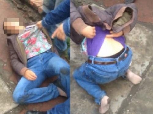 Video: Bị bắt quả tang dàn cảnh móc túi, người phụ nữ nằm lăn ra đường ăn vạ 1