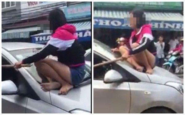 Giận nhau, vợ thản nhiên phóng xe mặc chồng vắt vẻo trên nắp ca-pô 1