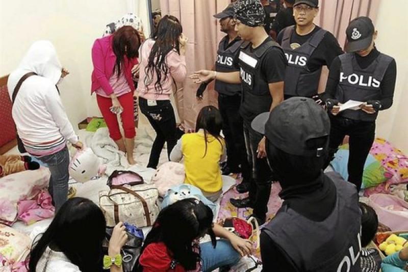 Hình ảnh Mở phiên tòa xét xử tội phạm buôn bán phụ nữ Việt Nam số 1