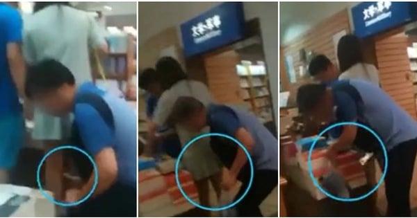 Gã biến thái vờ tìm sách để chụp trộm dưới váy phụ nữ 1