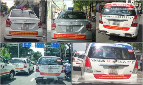 Xôn xao nhiều taxi ở TPHCM, Hà Nội dán decal phản đối Uber, Grab 1