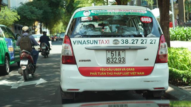 Vinasun yêu cầu tài xế gỡ biểu ngữ phản đối Uber, Grab 1