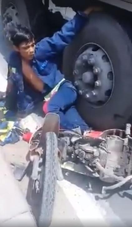 Hai vợ chồng bị container cán qua người, bất lực cầu cứu người đi đường 1