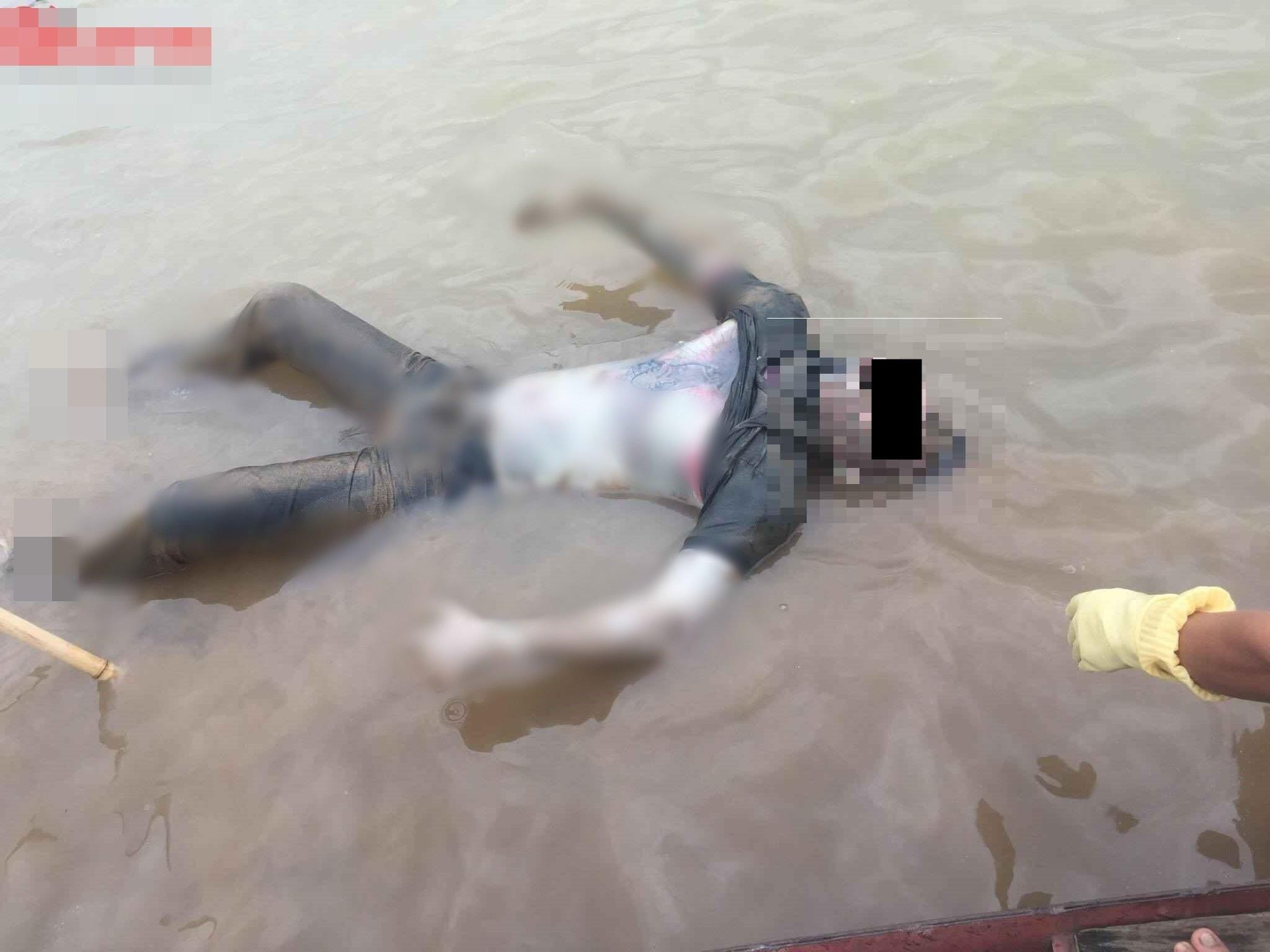 Hình ảnh Phát hiện xác nam thanh niên trôi nổi trên sông Hồng trong tư thế lạ số 1
