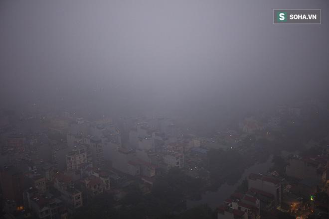 Hà Nội mờ ảo trong sương mù dày đặc 10