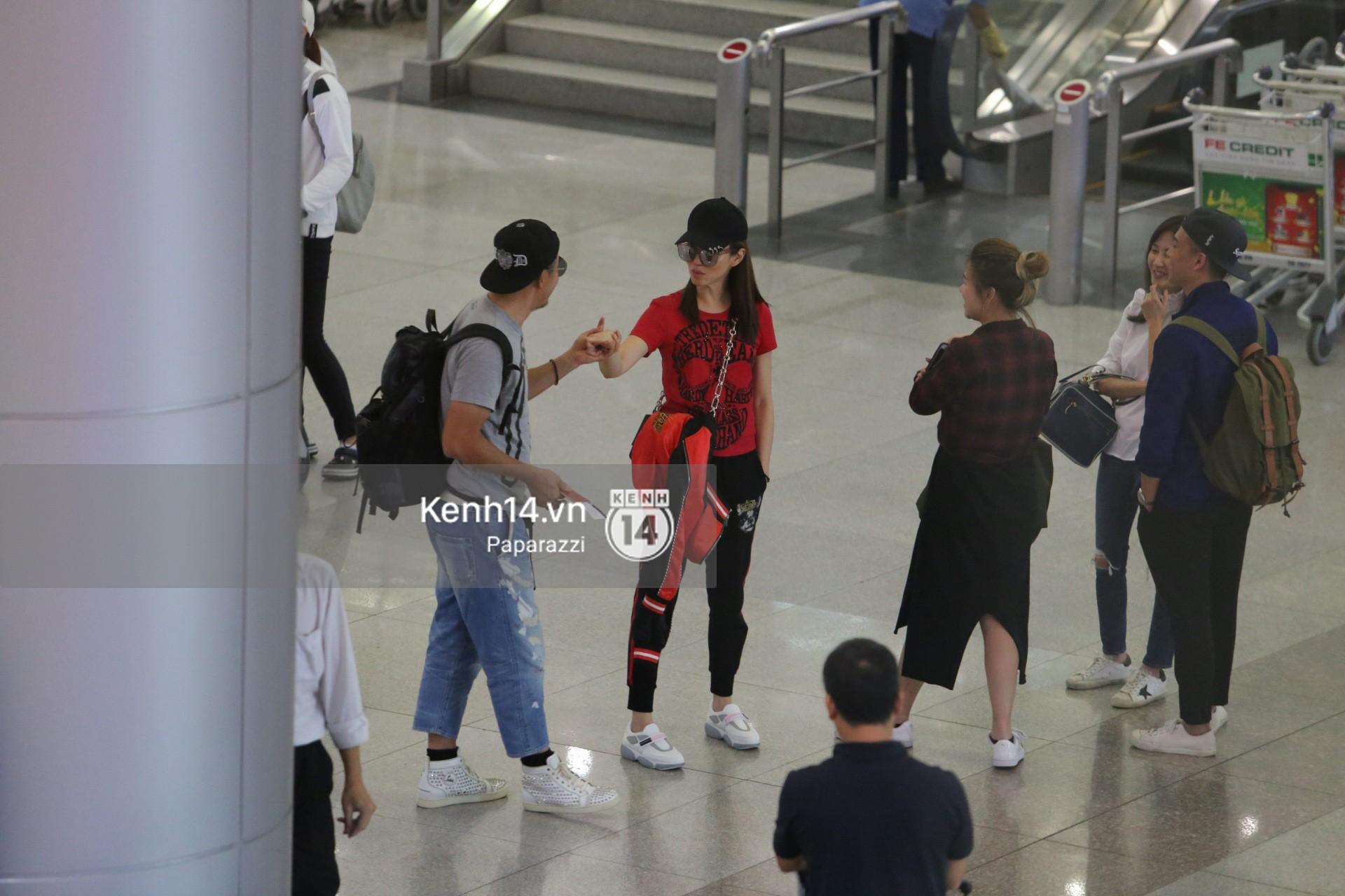 Vợ chồng Phạm Văn Phương - Lý Minh Thuận tay trong tay xuất hiện tại sân bay Tân Sơn Nhất 1