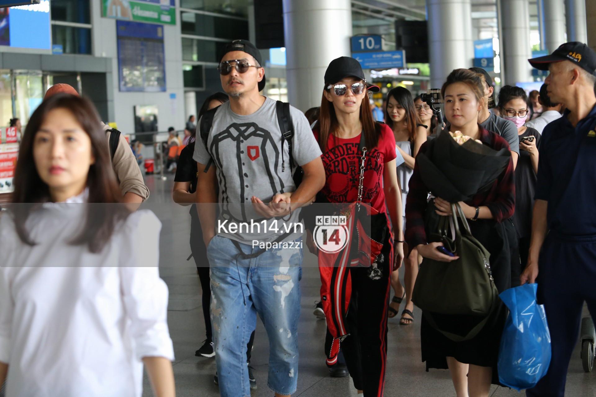 Vợ chồng Phạm Văn Phương - Lý Minh Thuận tay trong tay xuất hiện tại sân bay Tân Sơn Nhất 5
