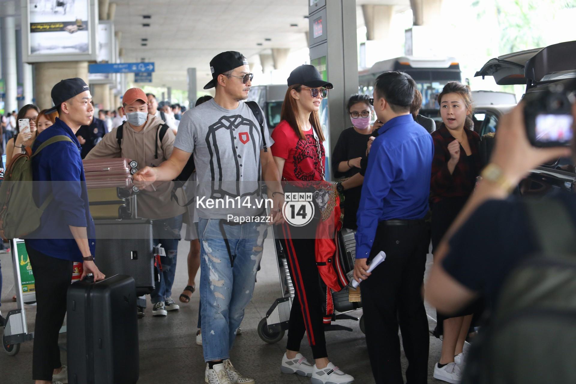 Vợ chồng Phạm Văn Phương - Lý Minh Thuận tay trong tay xuất hiện tại sân bay Tân Sơn Nhất 6