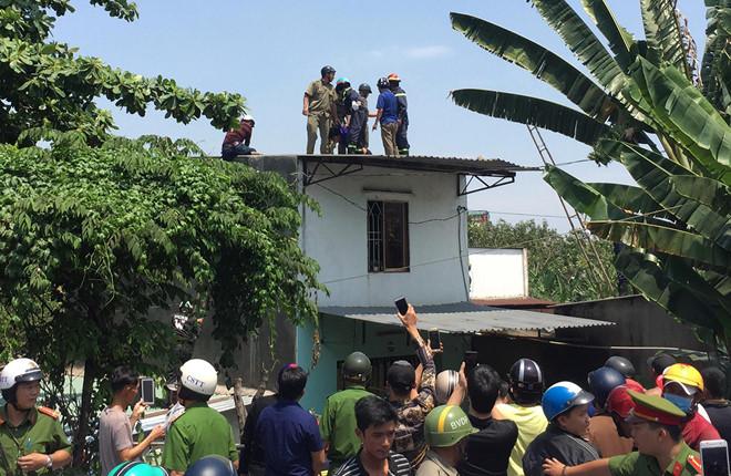 Thanh niên nghi 'ngáo đá' leo lên nhà dân cố thủ nhiều giờ, cầm gạch chống trả công an 3