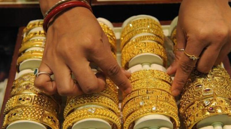 Hình ảnh Giá vàng ngày 26/4: Tụt giảm khi đồng USD tăng vọt số 1