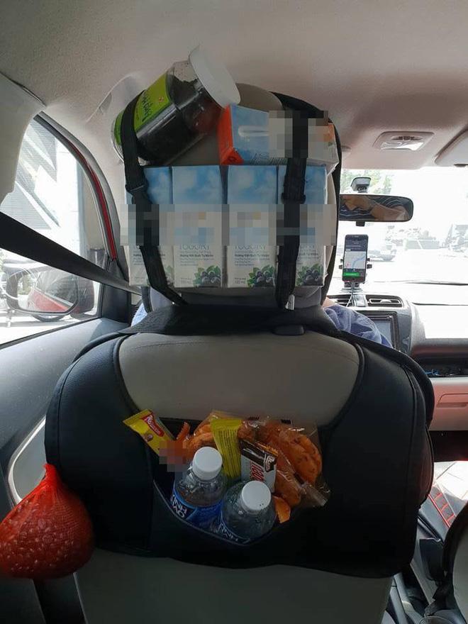 Hình ảnh Grabcar đầy ắp đồ ăn như tiệm tạp hóa thu nhỏ và tờ thông báo gây sốt trên mạng xã hội số 1