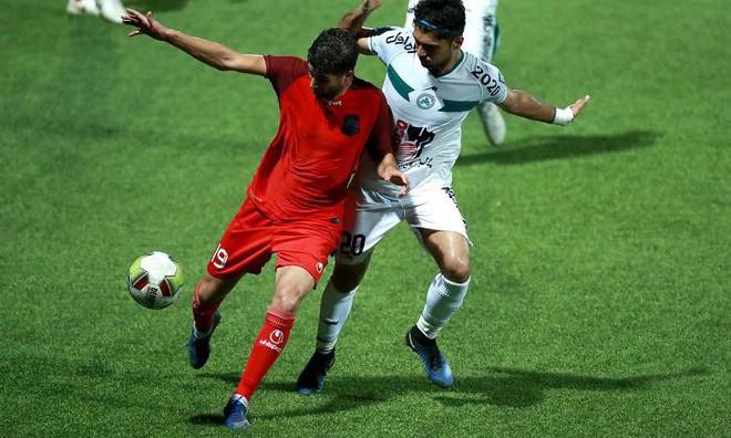 Đây là cách nữ nhiếp ảnh gia thể thao người Iran chụp ảnh trận đấu bóng đá dù bị cấm vào sân vận động 12