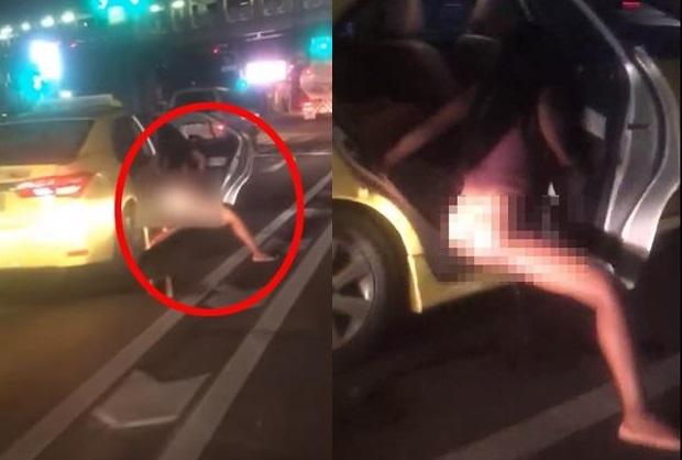 Clip: Người phụ nữ hồn nhiên thò chân xuống ôtô đi tiểu trong lúc dừng đèn đỏ 1