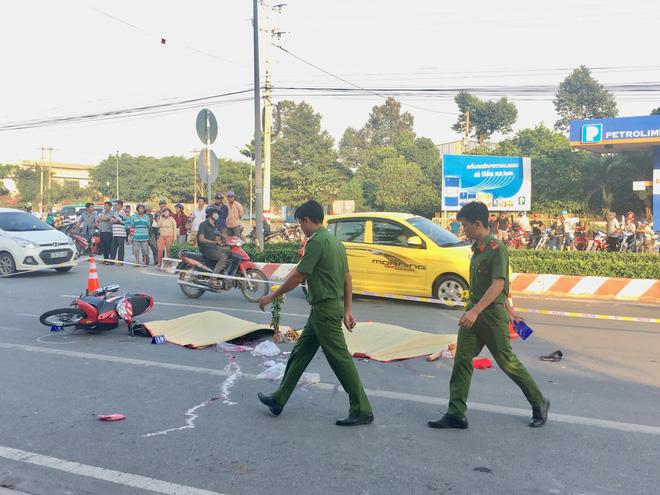 Chở con đi sắm Tết, 2 vợ chồng trẻ bị xe container cán tử vong thương tâm 1