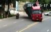 Video: Container lật nhào, xe máy đi cạnh thoát chết kỳ diệu