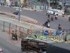 Xe tải bị lật ở Sài Gòn, hai thanh niên xăm trổ đầy mình 'hôi của'
