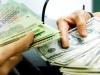 Ngân hàng Nhà nước Việt Nam phá giá tiền đồng thêm 1\%