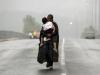 Ảnh người cha Syria hôn con gái trên đường tị nạn gây xúc động