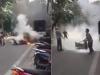 Cụ bà cầm bình cứu hỏa giải cứu xe máy cháy ngùn ngụt trên phố