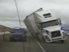Video: Xe container ngã đè bẹp xe cảnh sát vì gió quá lớn