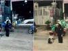 Người đàn ông đứng trong ổ gà dưới mưa gây tranh cãi cộng đồng mạng