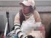Sự thật giật mình về người phụ nữ ngồi ôm con trong bọc ni lông