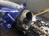Máy bay nổ động cơ trên không, hành khách bị hút ra cửa sổ