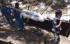 Malaysia phát hiện 139 ngôi mộ quanh các trại buôn người 4