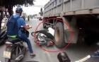 Người đàn ông may mắn thoát khỏi tử thần sau khi ngã trước bánh xe tải