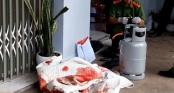 Cảnh sát phun vòi rồng khống chế tên giết người ôm bình gas cố thủ
