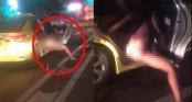 Clip: Người phụ nữ hồn nhiên thò chân xuống ôtô đi tiểu trong lúc dừng đèn đỏ