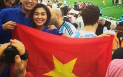 Hà Tăng cùng chồng giơ cao cờ Tổ quốc tại khán đài World Cup 2014