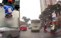 Video: Cháu bé suýt rơi khỏi xe máy vì ngủ gật