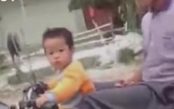 Video: Bé gái 2 tuổi phóng xe vun vút, chở theo ông phía sau