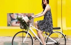 Tăng Thanh Hà rạng rỡ đạp xe, khoe vẻ đẹp hoàn hảo sau sinh