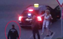Cảnh sát thờ ơ nhìn thiếu nữ bị nhét vào cốp xe khiến dư luận phẫn nộ