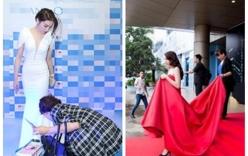 Giải trí - Hoa hậu Kỳ Duyên lại gây tranh cãi với hình ảnh mẹ nâng váy