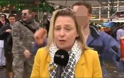 Video: Nữ phóng viên bị sàm sỡ khi đang lên sóng trực tiếp