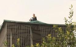 """Khống chế thanh niên nghi """"ngáo đá"""" 17 giờ nhảy múa trên mái nhà"""
