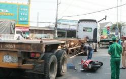 Xe container vượt đèn đỏ cán chết người, tài xế bị đánh bầm dập