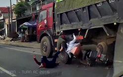 Lạng lách vượt ẩu, 2 cô gái rúc gầm xe tải